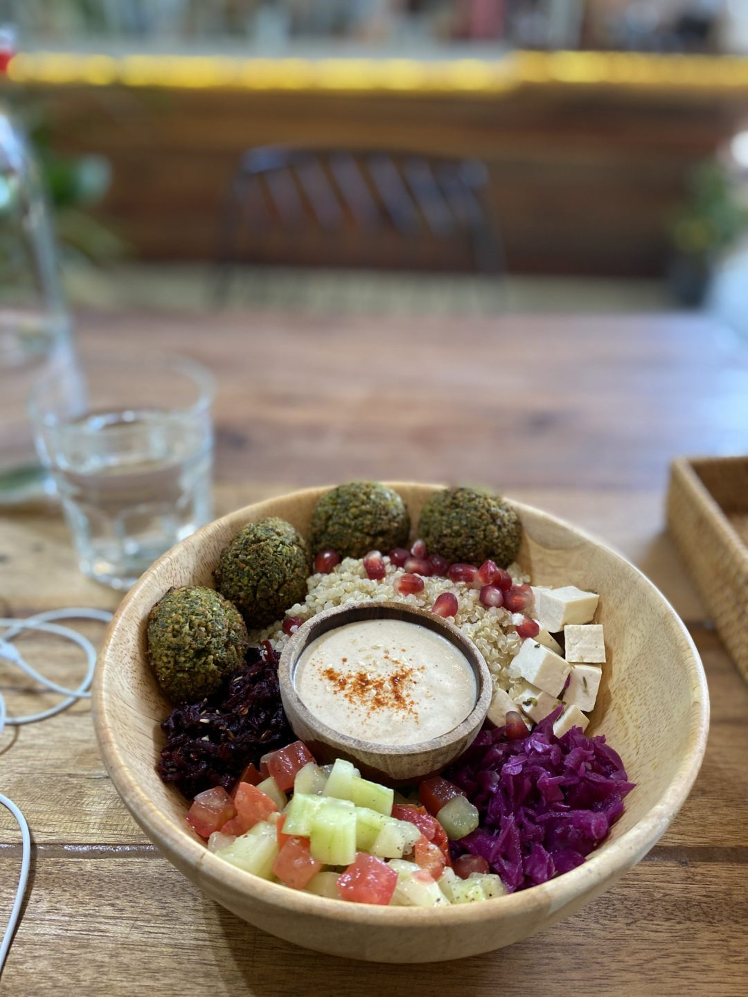 Wooden bowl with falafel and veggies