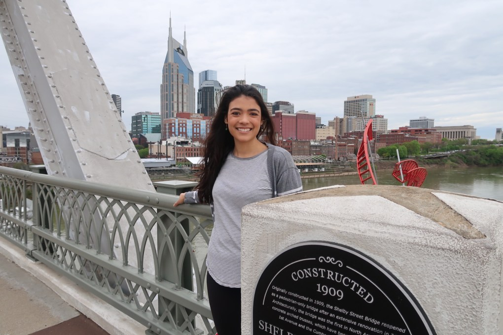 Girl on Nashville Pedestrian Bridge with downtown Nashville in the background