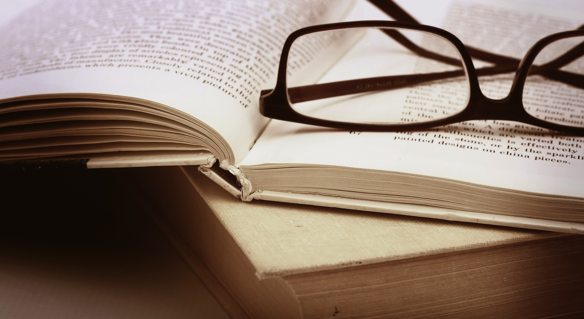 Image result for glasses on books