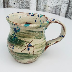 green slipware daisy mug by sarah monk