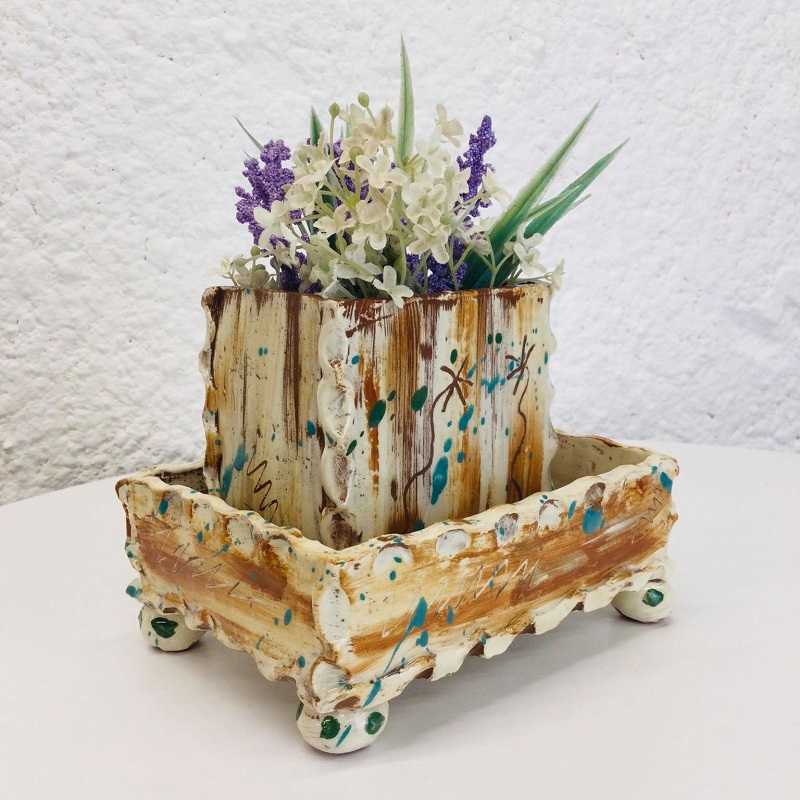 brown planter and tray with sgraffito daisies made by sarah monk ceramics, corner view