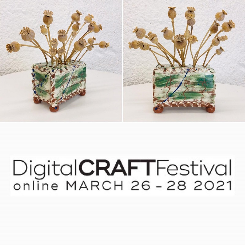 brushed dark green slipware  flower brick slab built by Sarah Monk Ceramics  with poppy seed head bouquet