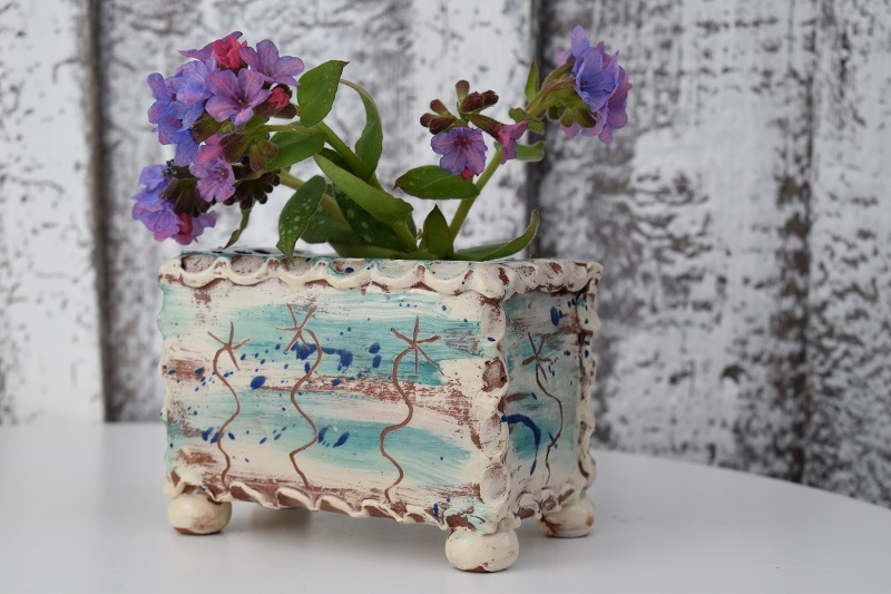 teal flower brick with fresh flowers by sarah monk ceramics