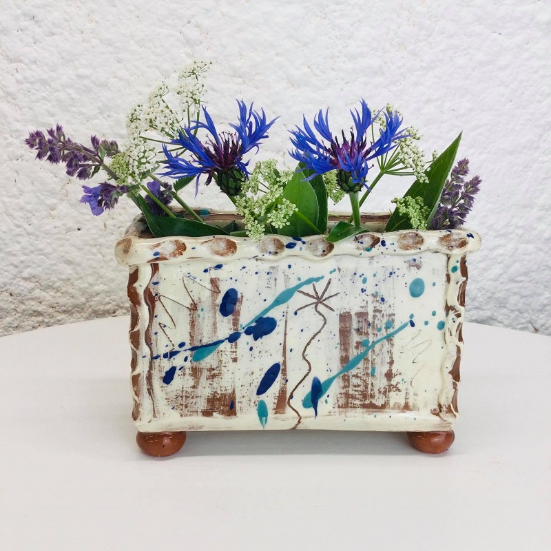 Rectangular slab vase with a single sgraffito daisy and scribbles by Sarah Monk