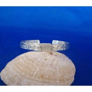 Silver Eagle Wolf Bracelet by Carmen Goertzen