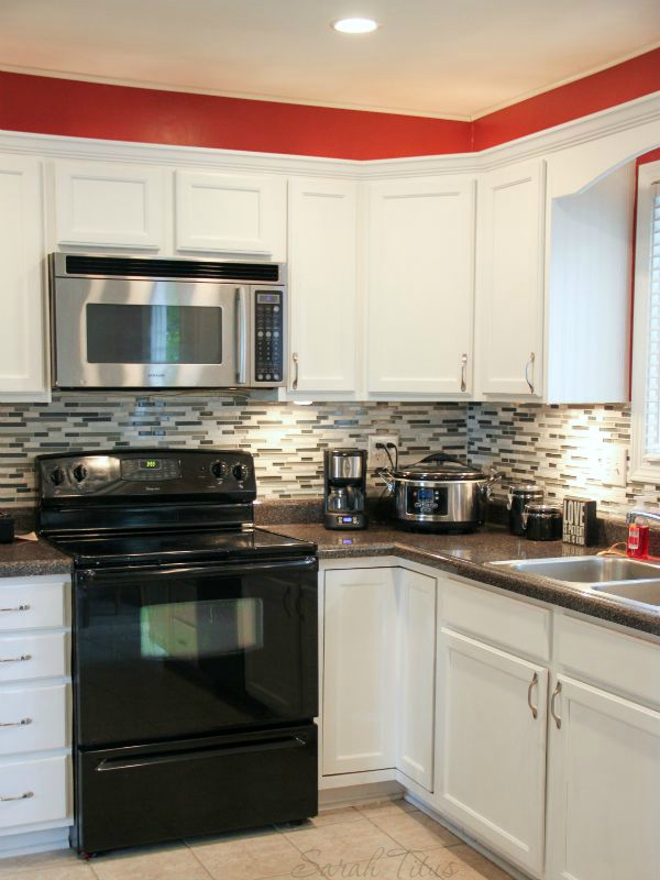 How To Remodel Your Kitchen On A Budget - Lighting-above-the-upper-cabinets-adds-warmth-to-the-kitchen
