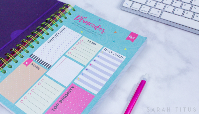 Planner and computer keyboard to start planning your mom blog