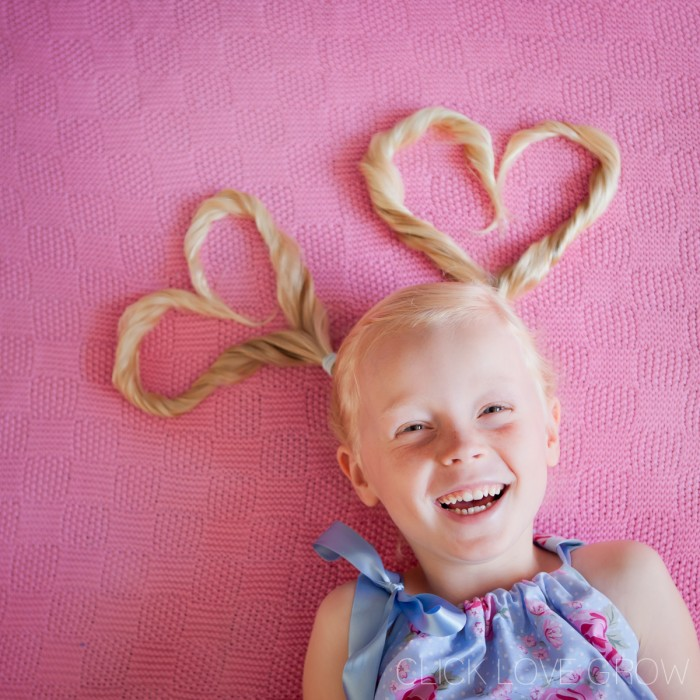 Fun shot of a smiling little girl with a fun hairdo