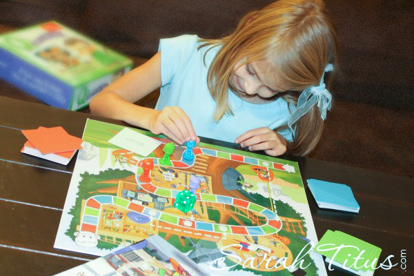 Little girl playing a board game