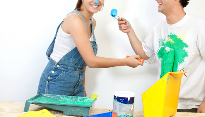 A couple painting together having fun