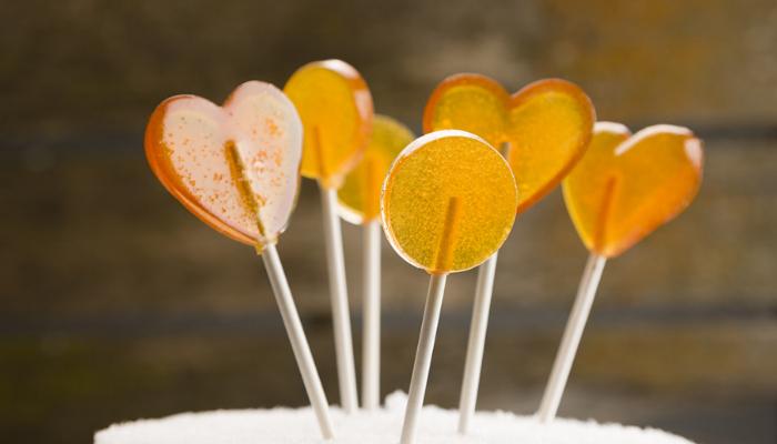 Golden colored heart shaped Easy Honey Lollipops