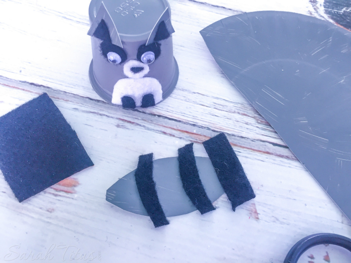 Attach little raccoon ears and make tail for K cup raccoon