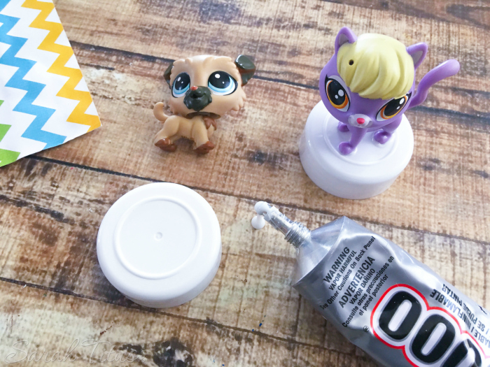 Glue Littlest Pet Shop figures to small lid with glue