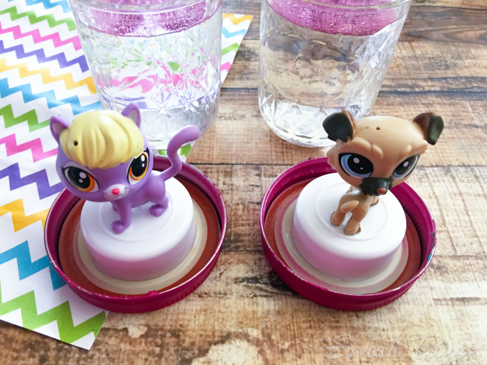 The liquid filled mason jars with the Littlest Pet Shop characters glued to the lids