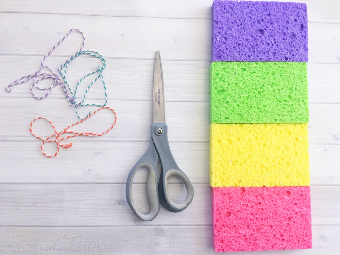 Supplies for sponge bombs: twine, scissors and multi colored sponges