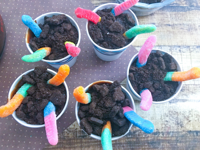 Filled cups with chocolate pudding and topped with crushed Oreo's and 3 gummy worms