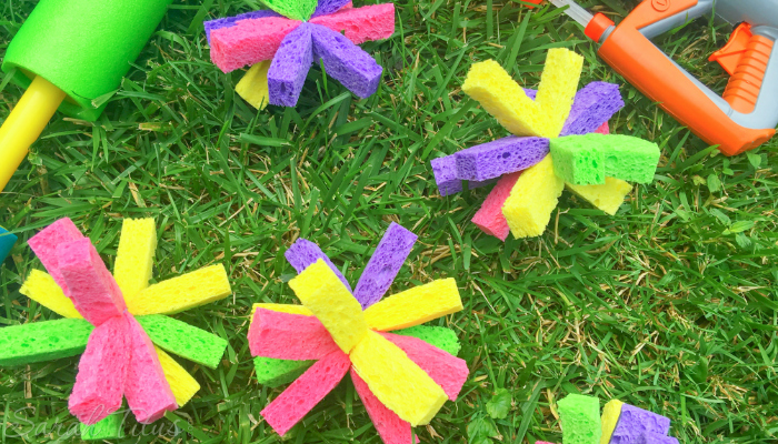 DIY Sponge bombs and water guns lying in the grass