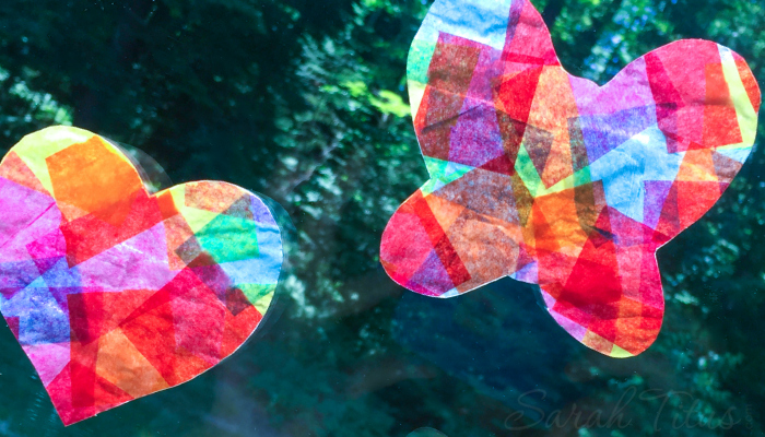 These tissue paper suncatchers are so fun to make and they keep the little ones entertained for hours! Put ribbon on the ends and fly them around the house like a kite!