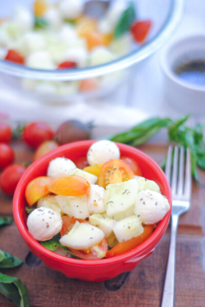 This Cucumber and Tomato Caprese Salad marries the flavors of tomato, basil, and mozzarella cheese together perfectly. This is one salad recipe you won't want to miss!