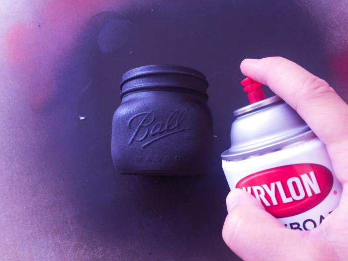 Spray painting mason jar with Chalkboard Paint