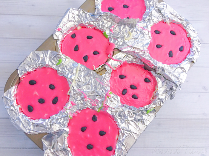"Pink layer of candy melts added to top of Watermelon Fudge and sprinkled black fondant ""seeds"" in a muffin tin"