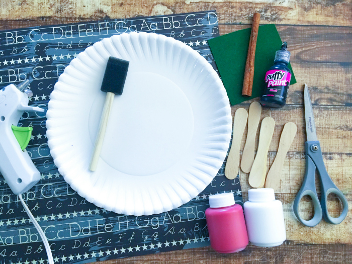 Supplies for Paper Plate Apple {Kids Craft} including glue gun, paint sponge, paper plates, paint, popsicle sticks and scissors