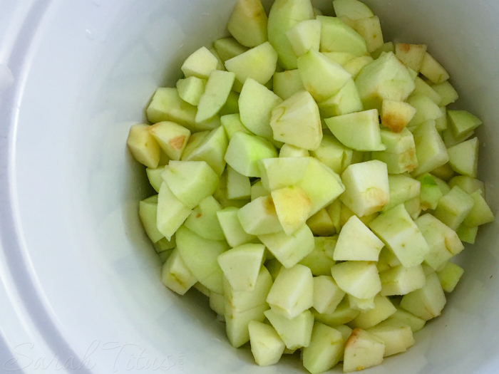 Chopped green apples in a white bowl in preparation for Crockpot Applesauce