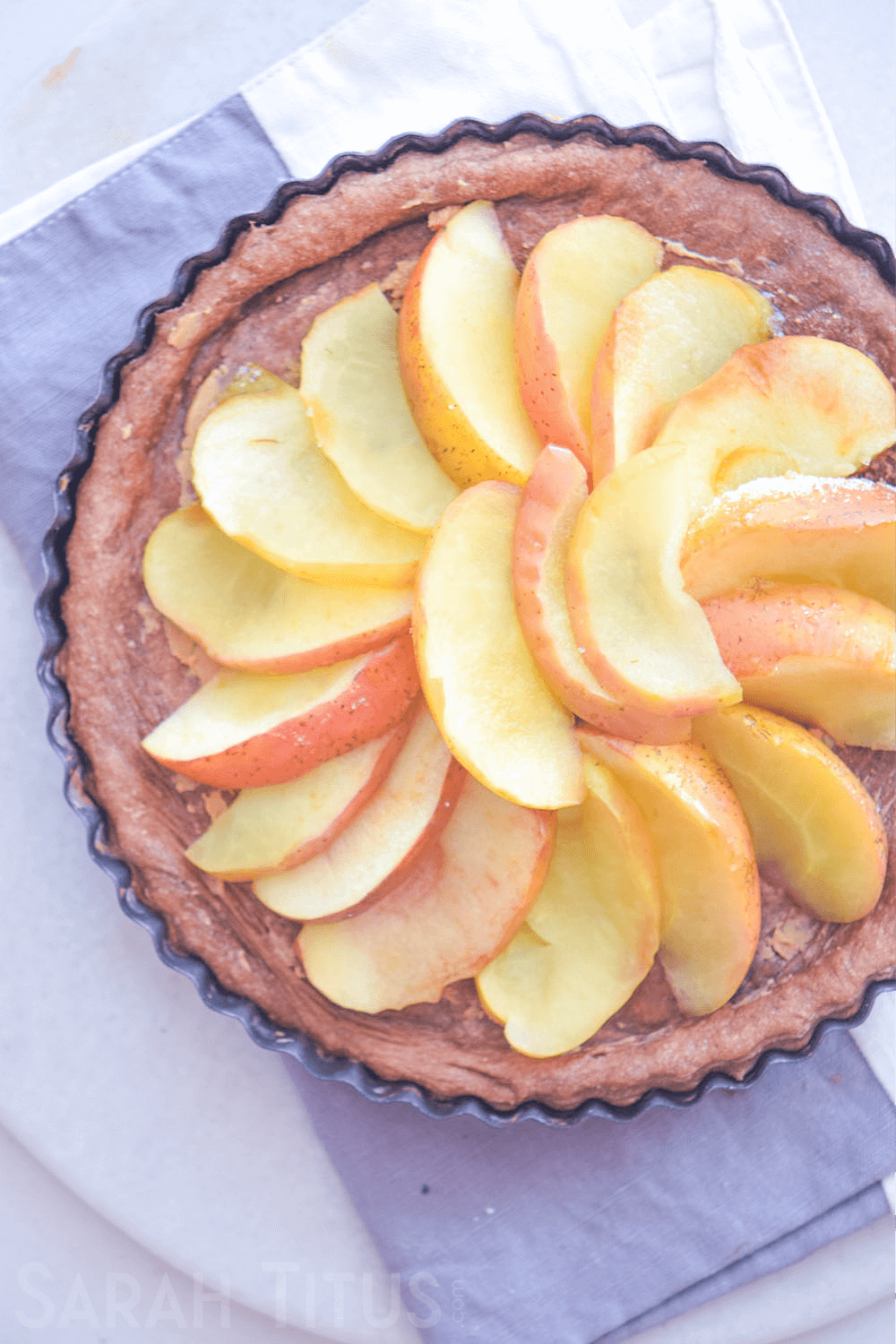 The beautifully finished circular design of apple slices on top of the pie