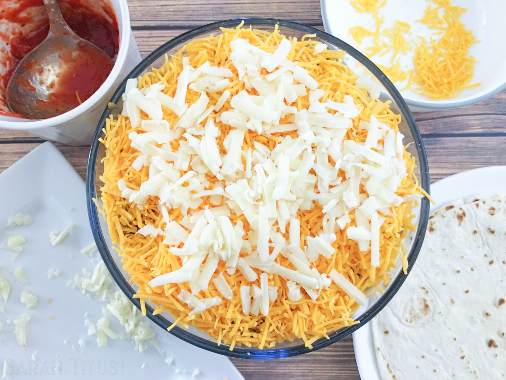Repeating thin layers of hamburger, salsa, cheese and tortillas till oven safe bowl is full