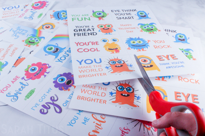 Trimming colorful printable monster Valentine's Day cards for kids