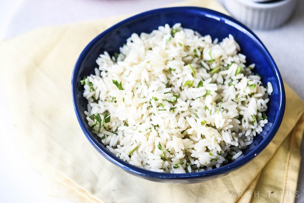 Rice is a great inexpensive side dish to add your dinner, but it is often bland and boring. This Lime Cilantro Rice is neither bland, nor boring and will have your family asking you to make more of it!