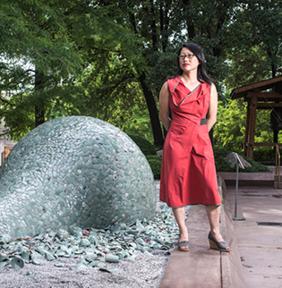 "Jean Shin poses with her piece ""Celadon Landscape"" in Japan"