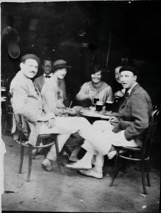 Ernest Hemingway with friends at a café in Pamplona, Spain (1925), Source: The John F. Kennedy Presidential Library and Museum
