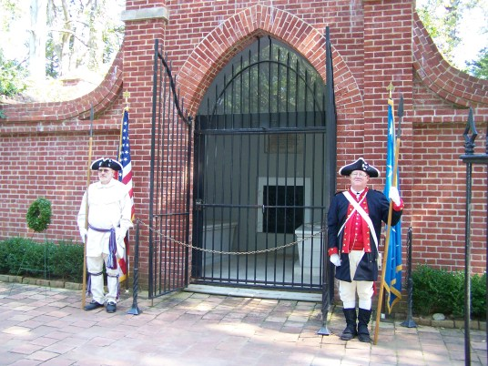 Two members of the Color Guard standing guard at Washington's tomb