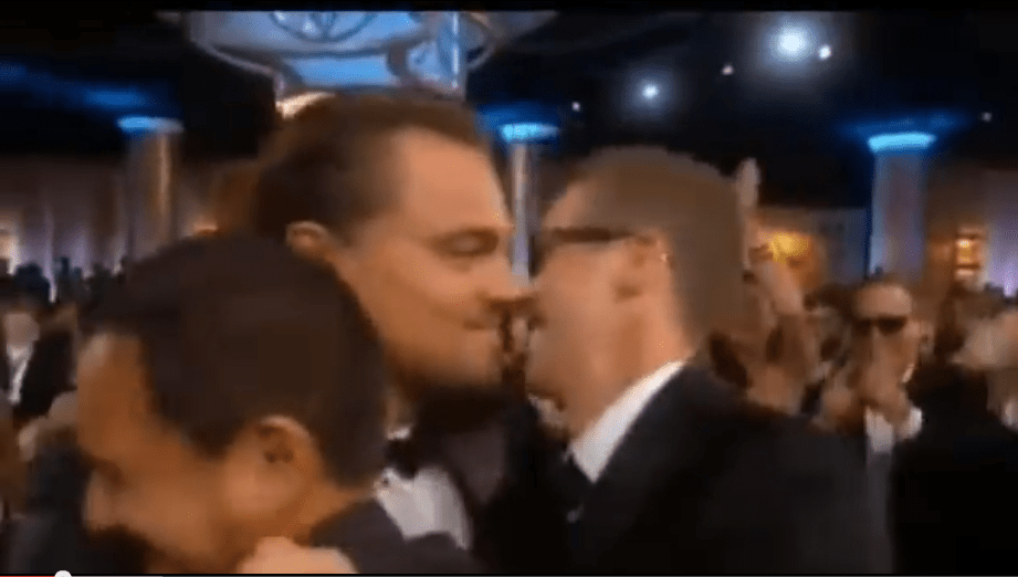 A hug for 'Riz and Joey' of Red Granite Pictures as Di Caprio makes his way to accept the Golden Globe for best actor