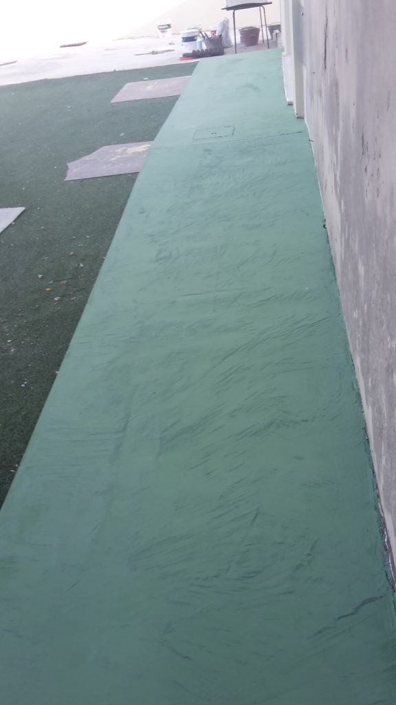 Rampa disabili in microcemento verde presso asilo Paulilatino