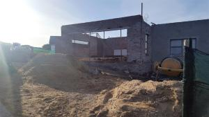 The outside view of a Sardinia Bay Estate home's building in progress.