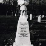 white marble gravestone black and white photo