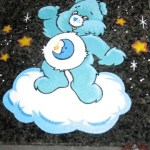 Headstone with blue care bear engraved
