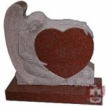 marble angel holding brown granite heart grave stone