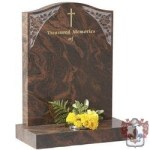 etched brown marble head stone