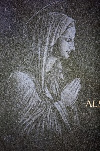 Our Lady engraved on headstone