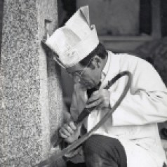 Bernard Sarsfield using an air tool to carve a memorial