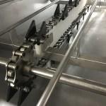 Laveuse de caisses grande cadence, construction en acier inoxydable - Entrainement chaîne grosse maille en inox