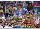 """""""Pat, Lesley & Maggie at Oxgangs Neighbourhood Centre's Christmas Fayre December 2014, displaying Christopher's range of mugs, cards, coasters, notebooks & table mats"""""""