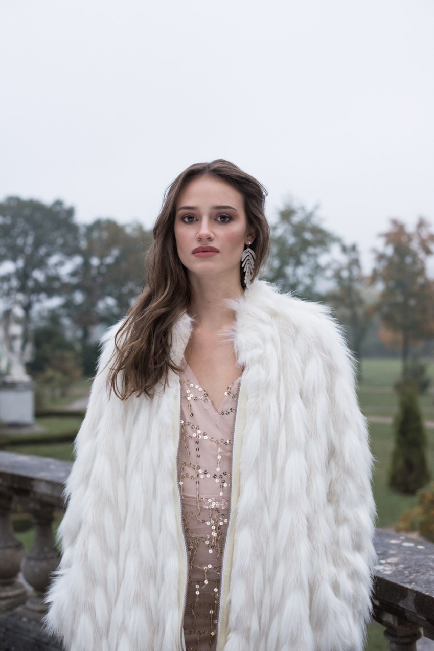 woman at her villa wearing designer fake fur coat by ferrari zoechling