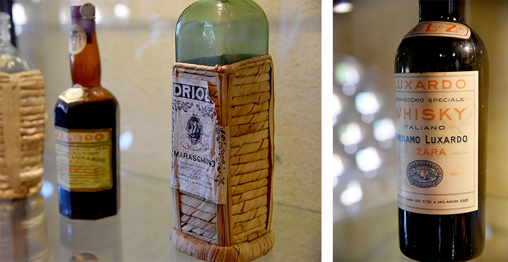 Old Luxardo bottles on display at the distillery