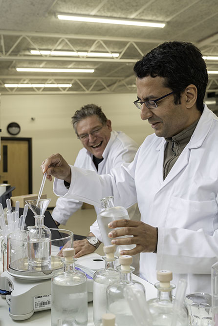 Paul and Mukund in the lab