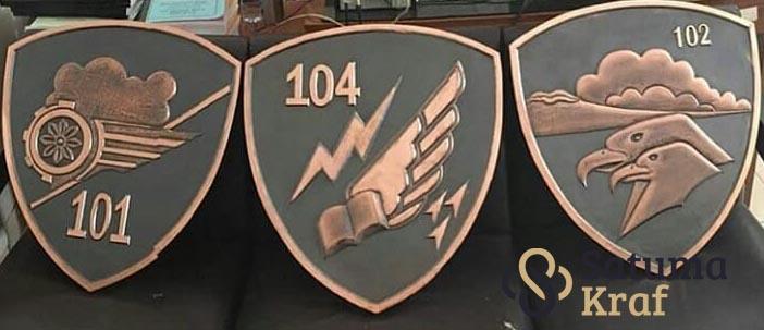 Logo Batalyon 102 tembaga