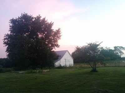 A sunset behind a barn on my parents' farm.